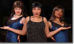 Photo of Lisa Payton, center, as Tina Turner with the Ikettes, left, Sarah Rex and, right, Mary Louise Lee