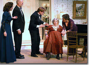 (Left to right) Kate Berry as Ruth Condomine, Mark Rubald as Dr. George Bradman, Steven Cole Hughes as Charles Condomine, Leslie O'Carroll as Madame Arcati, and Alex Ryer as Mrs. Violet Bradman