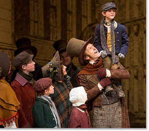 The Cratchits: James Michael Reilly as Bob Cratchit and Augie Reichert as Tiny Tim