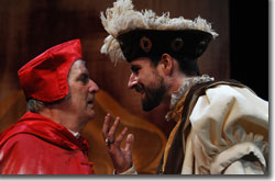 Left to Right: Julian López-Morillas as Cardinal Wolsey and Sean Tarrant as King Henry the Eighth