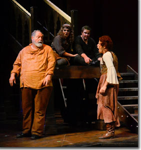 (Left to right, foreground) Michael Winters as Sir John Falstaff and Tammy L. Meneghini as Mistress Quickly