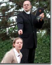 Photo: Paul Page (Reverend Jeremiah Brown) calls down fire and brimstone on his daughter, Kelly Burke (Rachel)