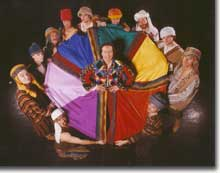 Photo of Scott Beyette as Joseph with his coat held by his 12 brothers