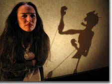 Photo of Karen Slack as Rebecca and shadow puppet