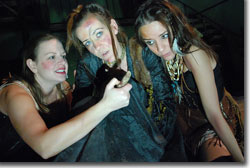 Lindsey Pierce, Trina Magness, and Jamie Romero as the three witches