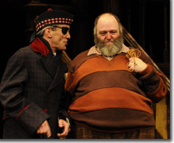 (Left to right) John Hutton as Ford and Brian Keith Russell as Sir John Falstaff