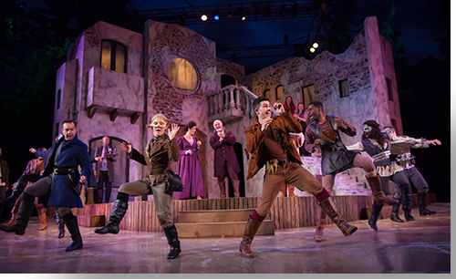 (Foreground: left to right) Rodney Lizcano as County Paris, Jessica Robblee as Benvolio, Marco Robinson as Tybalt, and Rakeem Lawrence as Gregory