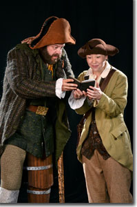 (Left to right) Logan Ernstthal as Long John Silver and Caroline Barry as Jim Hawkins