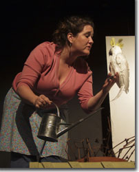 Hannah Duggan as Mrs. Hooks converses with her sulfur-crested cockatoo